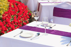 Outdoor tables with served plate and wine glasses Royalty Free Stock Photo