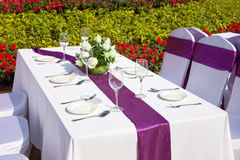 Outdoor tables with served plate and wine glasses Royalty Free Stock Photos