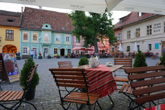 Outdoor tables in Sighisoara, Romania Stock Photos