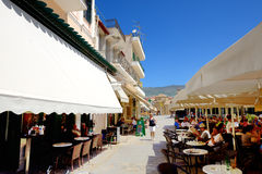 The outdoor tavern with local inhabitants and tourists Stock Images