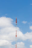 Outdoor tele communication red and white tower blue sky and clou Stock Photo