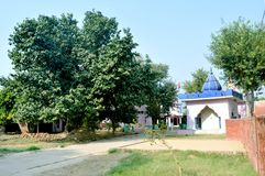 Outdoor temple in Indian Village. With Tree & Grass Stock Photos