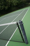 Outdoor tennis court. An angled perspective of an outdoor tennis court. Net is in the foreground Royalty Free Stock Images