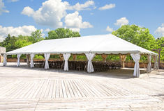 Outdoor tent for weddings or other festivity. Outdoor white tent for wedding or other festivity Stock Photos