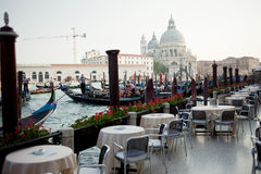 Outdoor terrace cafe overlooking the Grand canal Royalty Free Stock Photography