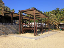 Outdoor terrace cafe on sand beach Royalty Free Stock Image