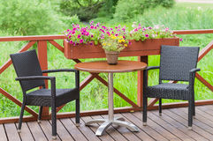 Outdoor terrace cafe table with two chairs Stock Images