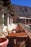 Outdoor terrace with chairs and table(Greece) Stock Photos