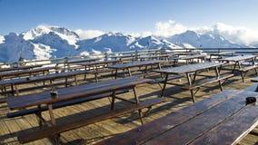 Outdoor terrace of a mountain restaurant in the Alps Stock Photos