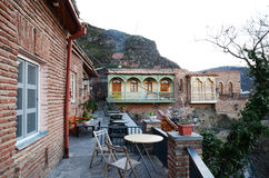 The outdoor terrace with tables. Residential houses on the hillside in Old Tbilisi Stock Photos