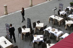 Outdoor terrazzo restaurants with waiters Royalty Free Stock Photo