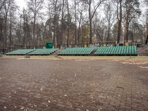 Outdoor theater in the park in the fall after the first snowfall Royalty Free Stock Photography