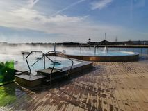 Outdoor thermal pool at Therme, Balotesti, Romania. Steam over the pool stock photo