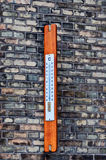 Outdoor thermometer. On background brick wall Royalty Free Stock Photos