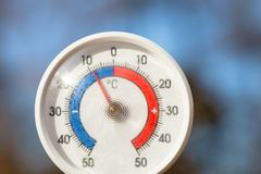 Outdoor thermometer with celsius scale showing severe freezing temperature. Cold winter weather concept stock photography