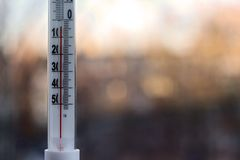 Outdoor thermometer with negative mark temperature on blurred background Stock Photos