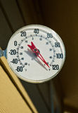Outdoor thermometer showing unusually hot summer temperature. Royalty Free Stock Images