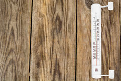 Outdoor thermometer on wood background Royalty Free Stock Image
