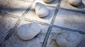 Outdoor Tic Tac Toe. An outdoor tic tac toe game made out of stones and concrete. Tic-tac-toe is a paper-and-pencil game for two players, X and O, who take turns Royalty Free Stock Images