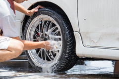 Outdoor tire car wash with sponge.  Stock Images