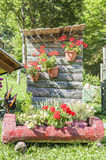 Outdoor toilet with flowers. Royalty Free Stock Image