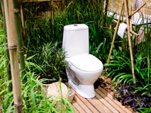 Outdoor toilet. In garden decor full nature Royalty Free Stock Images