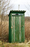 Outdoor toilet. Green outdoor toilet near the field, unsanitary concept village Royalty Free Stock Image