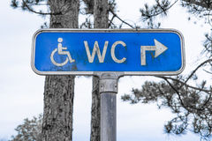 Outdoor toilet sign in blue color Stock Image