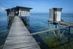 Outdoor toilet stilt house mabul island borneo. Stilt house in fishermans village on mabul island sabah borneo with toilet over the ocean Royalty Free Stock Photos