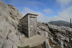 Outdoor toilet. Wooden outdoor toilet on mountain Royalty Free Stock Images