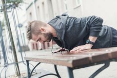 Outdoor training on a city bench. Royalty Free Stock Photography