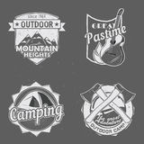 Outdoor travel logos. Set of outdoor travel logos. Camping badges. Mountain adventure labels, logotypes templates with hiking tackles: guitar, tent, axe Stock Image