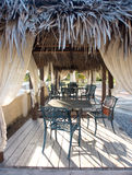 Outdoor tropical eating area. Outdoor restaurant in tropical resort Stock Image