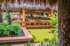 Outdoor tropical restaurant under palm leaf roof, Mexico 2015 Royalty Free Stock Photo