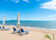 Outdoor with umbrella and chair on beautiful tropical beach and Stock Photos