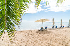 Outdoor with umbrella and chair on beautiful tropical beach and Royalty Free Stock Photography
