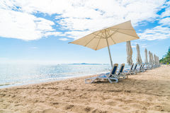 Outdoor with umbrella and chair on beautiful tropical beach and Stock Image