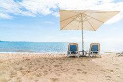 Outdoor with umbrella and chair on beautiful tropical beach and Royalty Free Stock Photos