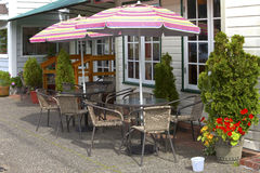 Outdoor umbrellas and chairs, Florence OR. Stock Photo