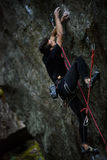 Outdoor unique  sports. Rock climber on a challenging ascent. Extreeme climbing. Royalty Free Stock Photos