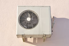 Outdoor Unit of Air Conditioner on the Wall Stock Photos
