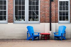 Outdoor urban relaxation Adirondack chairs in the city royalty free stock images
