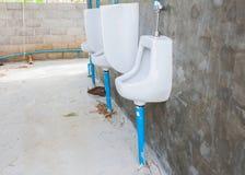 Outdoor of urinals men public toilet. Close up outdoor of urinals men public toilet Stock Images