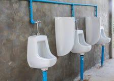 Outdoor of urinals men public toilet. Outdoor of urinals men public toilet background Royalty Free Stock Photo