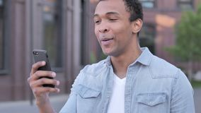 Outdoor Video Chat on Phone by African Man. 4k high quality, 4k high quality stock video footage