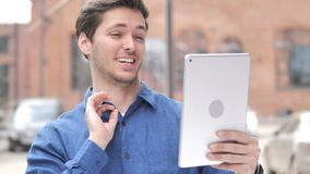 Outdoor Video Chat on Tablet by Young Man. 4k high quality, 4k high quality stock video footage