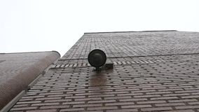 Dome surveillance camera on the school building recorded from below stock video