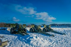 Outdoor view of antiaircraft gun in Trondheim. Norway, over the snow Stock Photo