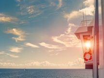 Outdoor view on captain cabin, glass control room and sunset sun through wind. Outdoor view on captain`s cabin, glass control room and sunset sun through window Stock Image