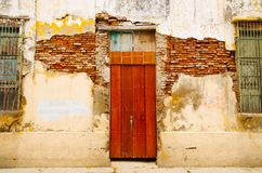 Outdoor view of damaged building with a wooden house in Santa Marta, Colombia.  Royalty Free Stock Images